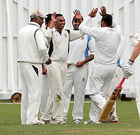 Vimal Arjan (3rd Left facing arms raised) is mobbed after taking a Brondesbury wicket during the Middlesex Cricket League Division Two game between Brondesbury and Wembley at Harman Drive, London on Sat Aug 1, 2015