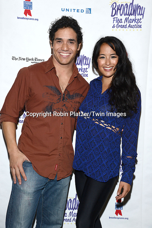 Adam Jacobs and Courtney Reed  attend the 28th Annual  Broadway Cares/ Equity Fights Aids Flea Market and Auction on September 21,2014 in Shubert Alley in New York City. <br /> <br /> photo by Robin Platzer/Twin Images<br />  <br /> phone number 212-935-0770