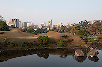 View of the 17th century Suizen-ji water garden juxtaposed against the modern cityscape
