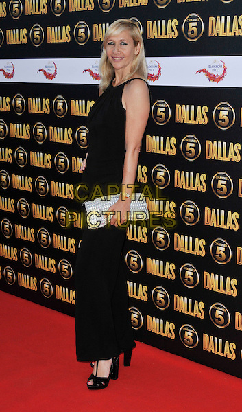 Tania Bryer.The Channel 5 Launch Party for the new series of 'Dallas', Old Billingsgate Market, London, England..21st August 2012.full length dress hand on hip silver clutch bag black sleeveless side .CAP/WIZ.© Wizard/Capital Pictures.