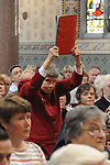 Rita O'Hare carries one of the gifts that was brought to the altar at the mass in St Mary's church for the last 3 remaining nuns from Mercy Convent who are leaving. Photo: www.colinbellphotos.com