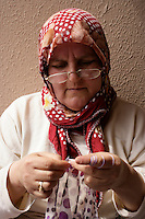 Turkish woman crocheting a headscarf edging in Istanbul, Turkey