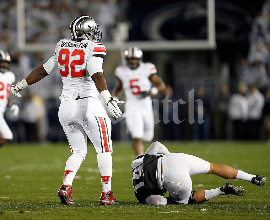 Ohio State Buckeyes defensive lineman Adolphus Washington (92) celebrates after sacking Penn State Nittany Lions quarterback Christian Hackenberg (14) during the 4th quarter of the NCAA Division I football game at Beaver Stadium in University Park, PA on October 25, 2014. (Columbus Dispatch photo by Jonathan Quilter)