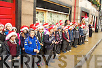 Children from the Holy Family School, Carol singing in Ashe street on Friday.