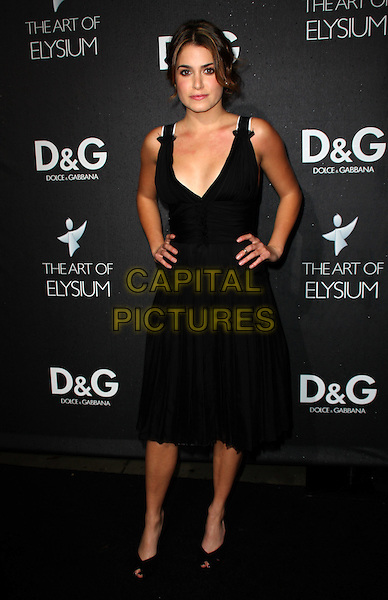 NIKKI REED.D&G Flagship Opening In Support of The Art of Elysium held at Dolce & Cabana Boutique, West Hollywood, California, USA..December 15th, 2008.full length black dress hands on hips.CAP/ADM/KB.©Kevan Brooks/AdMedia/Capital Pictures.