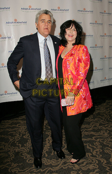 JAY LENO & MAVIS LENO.The 4th Annual Benefit Gala for Adopt-A-Minefield held at The Century Plaza Hotel in Century City, California.October 15th, 2004.full length, married, husband, wife, hand in pocket, red and orange fluorescent jacket, pinstripe suit.www.capitalpictures.com.sales@capitalpictures.com.©Debbie Van Story/Capital Pictures