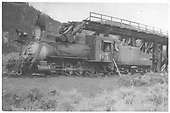 3/4 fireman's-side view of C&amp;S #65 near a trestle.<br /> C&amp;S