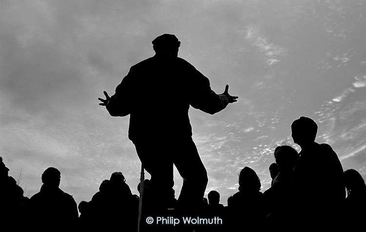 A speaker addresses a crowd at Speakers Corner, Hyde Park, London