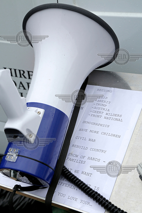 A megaphone and a list of subjects for speakers at an anti-Muslim rally.<br /> More than 150 members of the far-right 'Britain First' group gathered at Telford Central station on 22 February 2017 to march in protest at the 'horrors of Muslim grooming gangs' in the town they have dubbed the 'new Rotherham'. Some of the group spoke of an upcoming civil war against British Muslims, adding that they see 'taking to the streets' as the only way to make up for an establishment that refuses to act on their concerns.