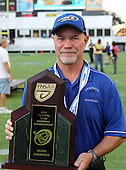 Armwood Hawks head coach Sean Callahan poses with the state title trophy after the Florida High School Athletic Association 6A Championship Game at Florida's Citrus Bowl on December 17, 2011 in Orlando, Florida.  Armwood defeated Miami Central 40-31.  (Photo By Mike Janes Photography)