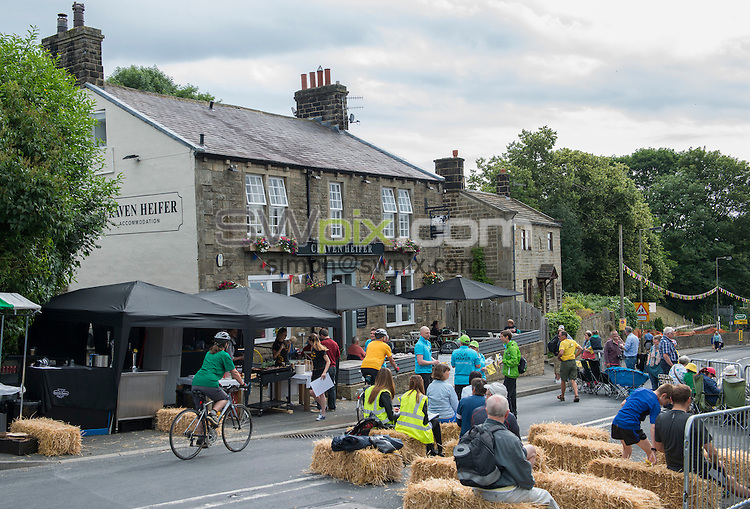 Picture by Allan McKenzie/SWpix.com - 06/07/2014 - Cycling - Tour de France 2014 - Stage 2, York to Sheffield - Yorkshire, England - Crowds begin to gather early at the Craven Heifer in Addingham.