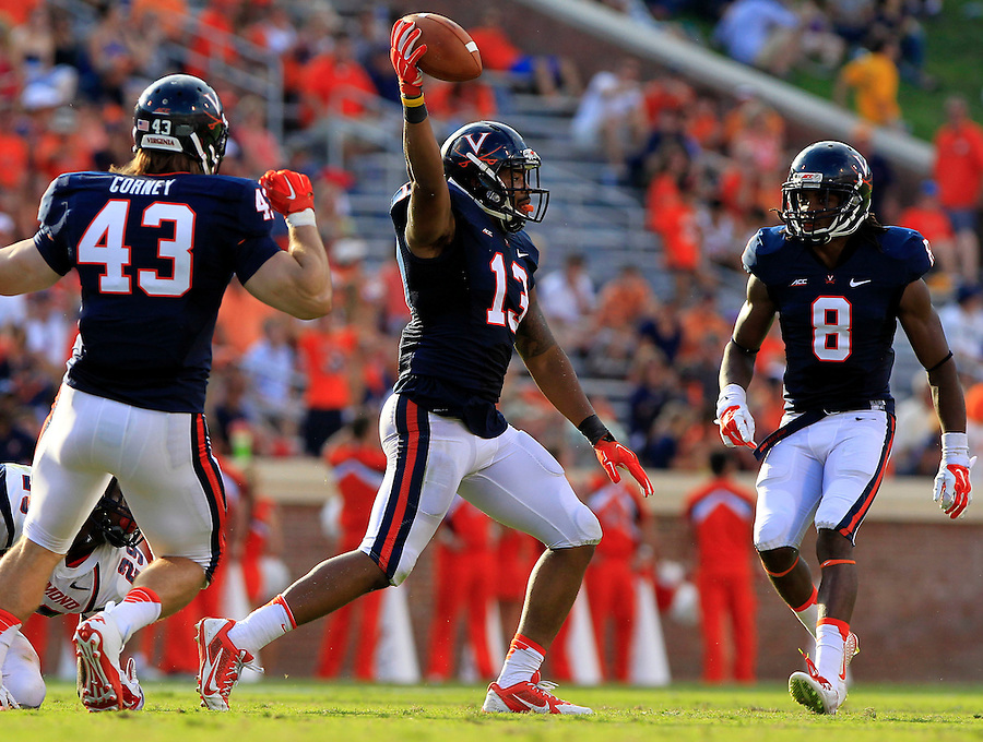 Virginia linebacker Daquan Romero (13) reacts after intercepting the ball in the third quarter with teammate defensive end Trent Corney (43) and safety Anthony Harris (8) during the game Saturday Sept. 6, 2014 at Scott Stadium in Charlottesville, VA. Virginia defeated Richmond 45-13. Photo/Andrew Shurtleff