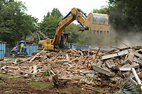 NWA Democrat-Gazette/ANDY SHUPE<br /> Workers operate heavy equipment Wednesday, Aug. 9, 2017, to demolish Stone-Hilton House at 306 E. Lafayette St. in Fayetteville. Though concerned neighbors in the Washington-Willow Historic District launched a campaign to save it, the historic house was demolished after it was deemed too damaged to be restored.