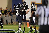 24 September 2011:  FIU quarterback Jake Medlock (12) celebrates his third-quarter touchdown with FIU running back Kedrick Rhodes (9) as the University of Louisiana-Lafayette Ragin Cajuns defeated the FIU Golden Panthers, 36-31, at FIU Stadium in Miami, Florida.