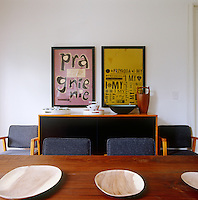 Mid-century chairs by Jens Risom for Knoll flank the wooden table in the dining room