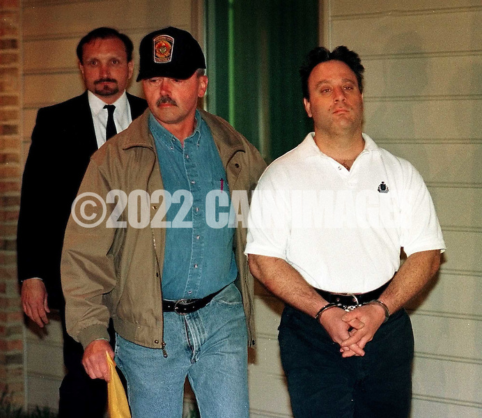 John Denofa, right, 35, of Buckingham, Pa., is led by an unidentified Bucks County Constable, to a vehicle, for transportation to Bucks County Prison, after his arraignment, Friday, April 7, 2000, in Ottsville, Pa. Denofa is charged with the murder of Rachel Siani, the exotic dancer and college student. Siani's corpse was found April 1, in Burlington, NJ. (Photo by William Thomas Cain/Cain Images)