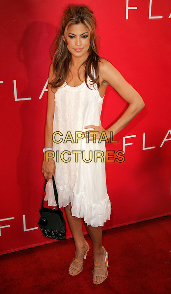 "EVA MENDES.At Revlon party to launch ""Flair"" Fragrance at Mr. Chow, New York, NY ,USA..May 22nd, 2006.Photo: Jackson Lee/AdMedia/Capital Pictures.Ref: JL/ADM.half length black purse white dress hand on hip.www.capitalpictures.com.sales@capitalpictures.com.© Capital Pictures."