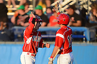Batavia Muckdogs third baseman Blake Barber #23 high fives Connor Burke #16 after scoring a run during a game against the Auburn Doubledays on June 18, 2013 at Dwyer Stadium in Batavia, New York.  Batavia defeated Auburn 10-2.  (Mike Janes/Four Seam Images)