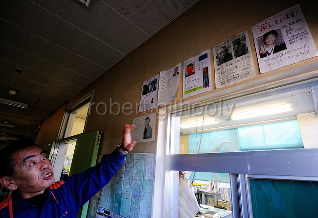 A member of the local Fujitoshida fire department points to a row of missing persons profiles of people who may have taken their lives in Aokigahara Jukai, better known as the Mt. Fuji suicide forest, which is located at the base of Japan's famed mountain west of Tokyo, Japan. ..