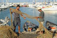 - fishermen in the port of Sidi Bou Said town....- pescatori  nel porto della città di Sidi Bou Said
