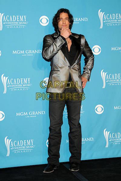 JOE NICHOLS .45th Annual Academy Of Country Music Awards - Press Room held at the MGM Grand Garden Arena, Las Vegas, Nevada, USA..April 18th, 2010.ACM CMA full length jeans denim black jacket grey gray silver blazer hand on hip chin posing .CAP/ADM/BP.©Byron Purvis/AdMedia/Capital Pictures.