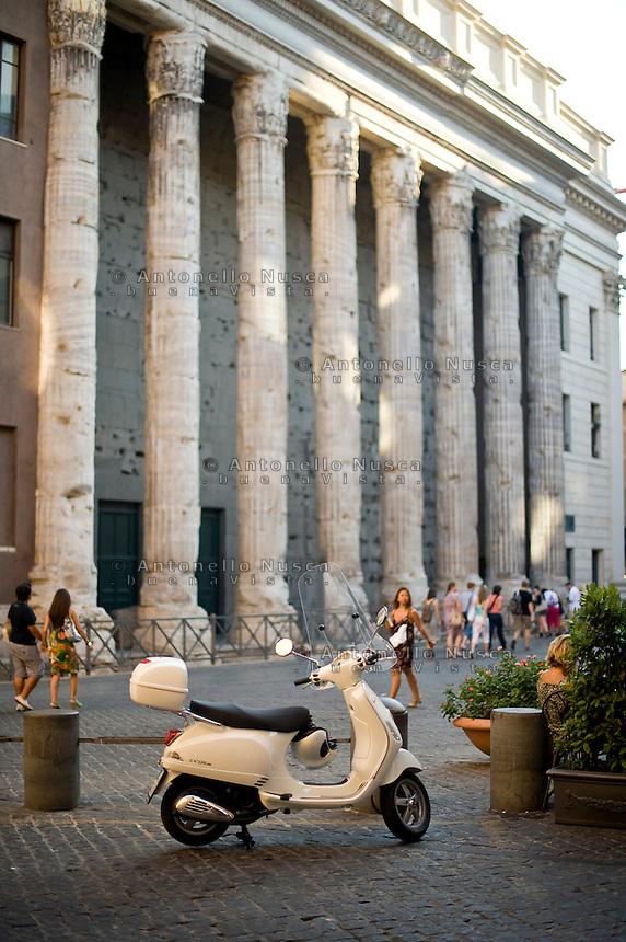 A Vespa scooter parked in Piazza di Pietra in Rome.