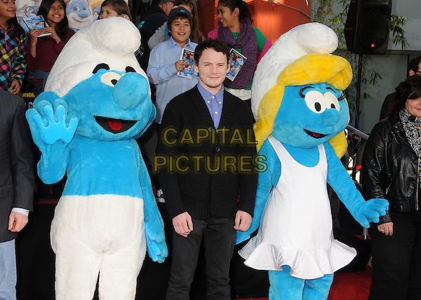 Clumsy Smurf, Anton Yelchin, Smurfette.The Smurfs Hand and Footprint Ceremony held at Grauman's Chinese Theatre, Hollywood, California, USA..December 13th, 2011.half length costume white dress trousers hat black suit blue shirt.CAP/ADM/BP.©Byron Purvis/AdMedia/Capital Pictures.