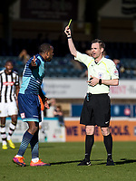 Referee Ross Joyce brandishes a yellow card to Myles Weston of Wycombe Wanderers during the Sky Bet League 2 match between Wycombe Wanderers and Notts County at Adams Park, High Wycombe, England on the 25th March 2017. Photo by Liam McAvoy.