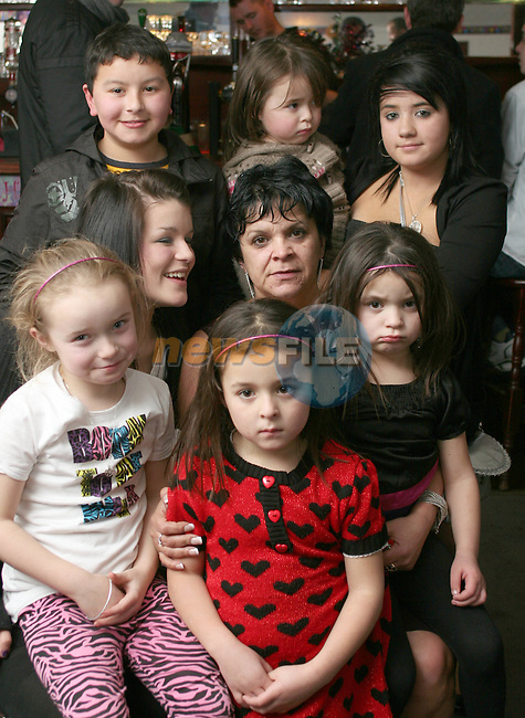 Audrey Hughes with her grandchildren at her  50th in The Trinity Arms...Photo NEWSFILE/Jenny Matthews.(Photo credit should read Jenny Matthews/NEWSFILE)....This Picture has been sent you under the condtions enclosed by:.Newsfile Ltd..The Studio,.Millmount Abbey,.Drogheda,.Co Meath..Ireland..Tel: +353(0)41-9871240.Fax: +353(0)41-9871260.GSM: +353(0)86-2500958.email: pictures@newsfile.ie.www.newsfile.ie.FTP: 193.120.102.198.
