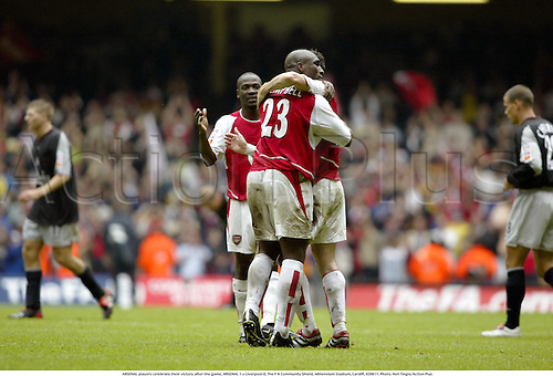 ARSENAL players celebrate their victory after the game, ARSENAL 1 v Liverpool 0, The F A Community Shield, Millennium Stadium, Cardiff, 020811. Photo: Neil Tingle/Action Plus...soccer association football.2002.english league.charity.celebrates celebration celebrating celebrations joy.win wins winners winner