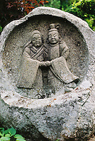 A Dosojin statue protects travellers and children near Shimosuwa, Japan