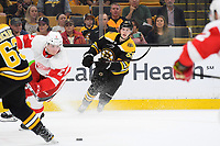 September 26, 2018: Boston Bruins defenseman Urho Vaakanainen (58) passes the puck during the NHL pre-season game between the Detroit Red Wings and the Boston Bruins held at TD Garden, in Boston, Mass. Detroit defeats Boston 3-2 in overtime. Eric Canha/CSM