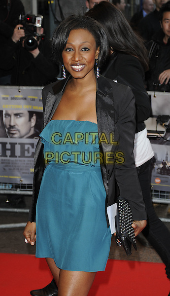 BEVERLEY KNIGHT .World Premiere of 'The Heavy' at the Odeon West End, Leicester Square, London, England, UK..April 15th 2010 .arrivals half length black jacket green dress clutch bag studs studded  beverly .CAP/CAN.©Can Nguyen/Capital Pictures.