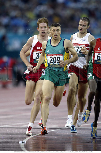 209. YOUCEF ABDI (AUS), Men's 1500 Metres Semi Final, 2002 Manchester Commonwealth Games, City of Manchester Stadium, 020730. Photo: Neil Tingle/Action Plus...athletics athletes athlete.runner runners run running.track event.distance.................................