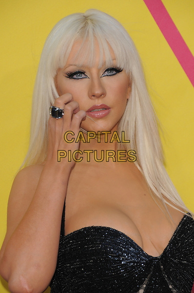 CHRISTINA AGUILERA .attends The 2008 MTV Video Music Awards held at Paramount Studios in Hollywood, California, USA, .September 07 2008.                                                                     .VMA Vmas arrivals portrait headshot  straight hair fringe black halterneck dress beaded silver grey gray  eyeliner make-up cleavage hand ring touching face scratching .CAP/DVS.©Debbie VanStory/Capital Pictures