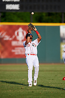 Greeneville Reds left fielder Reniel Ozuna (27) settles under a fly ball during a game against the Pulaski Yankees on July 27, 2018 at Pioneer Park in Tusculum, Tennessee.  Greeneville defeated Pulaski 3-2.  (Mike Janes/Four Seam Images)