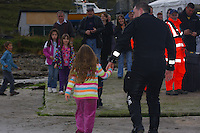 Saturday Oct 10 2009.  SCUBADIVE WEST, GALWAY, IRELAND:  Paul Devane is greeted by  family, friends and applause after arriving on shore when technical difficulties forced him from the water during the sixth hour of his world record attempt with his brother Declan to be the first divers to stay underwater on SCUBA for a period of 24-hours.