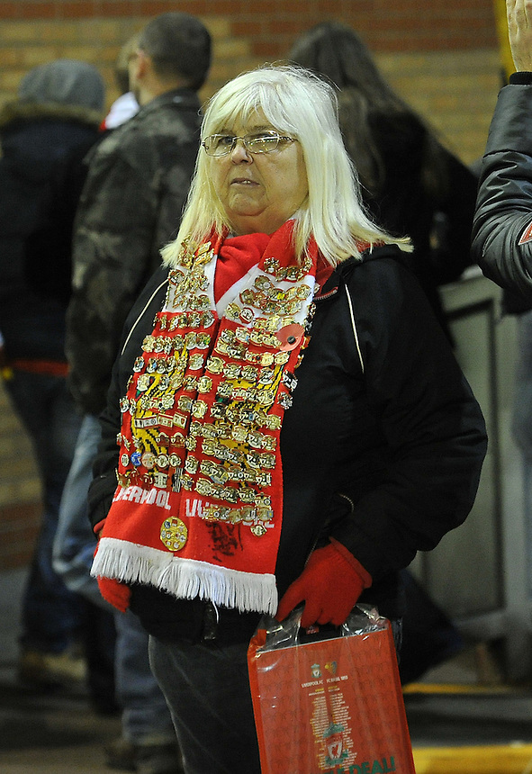 A Liverpool fan is dejected as her beloved team exit the Champions League<br /> <br /> Photographer Dave Howarth/CameraSport<br /> <br /> Football - UEFA Champions League Group B - Liverpool v Basel - Tuesday 9th December 2014 - Anfield - Liverpool<br /> <br /> &copy; CameraSport - 43 Linden Ave. Countesthorpe. Leicester. England. LE8 5PG - Tel: +44 (0) 116 277 4147 - admin@camerasport.com - www.camerasport.com