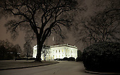 View of the North Portico of the White House in Washington, DC during the first measurable snowfall of the winter on January 20, 2016. President Obama had to motorcade back to the White House from Andrews Joint Base due to the  wintery weather. <br /> Credit: Olivier Douliery / Pool via CNP