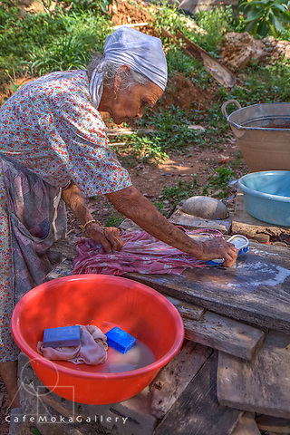 Granny Augustine washing clothes by hand