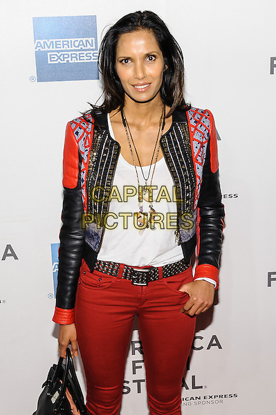 Padma Lakshmi.'Sunlight Jr' screening at TriBeCa Film Festival, New York, New York, USA, 20th April 2013..half length red leather jacket jeans bag white vest top necklace beads gold embellished patterned belt .CAP/ADM/MS.©Mario Santoro/AdMedia/CapitalPictures .