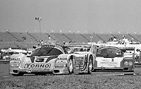 The #3 Porsche 962 of Oscar Larrauri, Gianfranco Brancatelli, and Massimo Sigala  leads the #1 Porsche 962 of A.J. Foyt, Al Unser and Danny Sullivan during the Rolex 24 at Daytona, Daytona International Speedway, Daytona Beach, FL, February 1, 1987.  (Photo by Brian Cleary/www.bcpix.com)