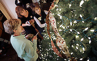 NWA Democrat-Gazette/DAVID GOTTSCHALK Vicki Proffer (from left), Renee Barriere and Melody Martens, members of the Bentonville Garden Club, decorate the Christmas Tree in the atrium of the Peel Mansion Tuesday, December 1, 2015 in Bentonville. The annual seasonal decoration of the mansion coincides with the Gala at the Peel Mansion taking place December 12 and benefitting The (cq) Peel Compton Foundation.