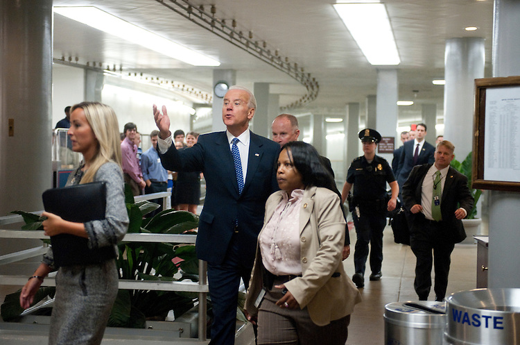 UNITED STATES - AUGUST 1: Vice President Joe Biden gestures to tourists, visitors and staff as he walks from the Russell Senate Office Building to the Capitol to attend the Senate Democrats' caucus meeting on the debt ceiling on Monday August 1, 2011. (Photo By Bill Clark/Roll Call)