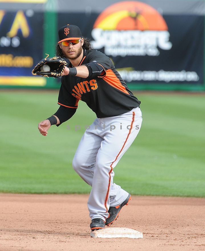 San Francisco Giants Brandon Crawford (35) at a workout day during spring training on February 23, 2014 in Phoenix, AZ