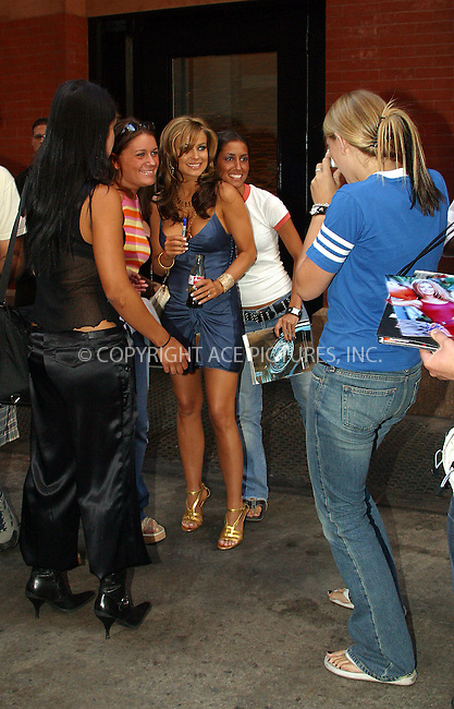 Carmen Electra and boyfriend musician Dave Navarro getting surrounded by fans as they depart their hotel to go to 2003 Video Music Awards. New York, August 28, 2003. Please byline: NY Photo Press.   ..*PAY-PER-USE*      ....NY Photo Press:  ..phone (646) 267-6913;   ..e-mail: info@nyphotopress.com