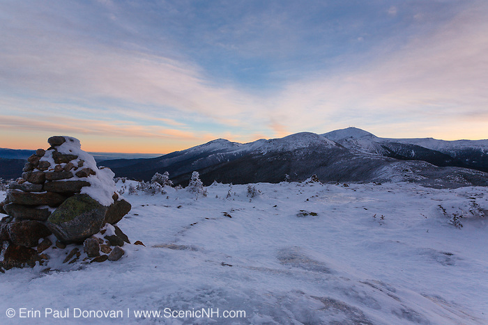 The Presidential Range from the summit of Mount Pierce in the White Mountains, New Hampshire USA at sunrise. Rock Cairns, seen in the foreground, mark the route of hiking trails in the alpine zones.