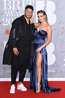 LONDON, UK. February 20, 2019: Alex Oxlade Chamberlain & Perry Edwards arriving for the BRIT Awards 2019 at the O2 Arena, London.<br /> Picture: Steve Vas/Featureflash<br /> *** EDITORIAL USE ONLY ***