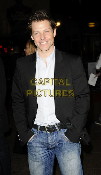"JAMIE BAMBER.World Premiere of ""The Damned United"" at the Vue West End, Leicester Square, London, England..March 18th 2009.half length black suit jacket pale blue shirt jeans denim hands in pockets .CAP/CAN.©Can Nguyen/Capital Pictures."