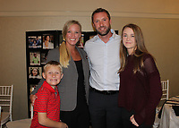 NWA Democrat-Gazette/CARIN SCHOPPMEYER The Kingston family helps support Project Zero at Aiming for Zero NWA on Nov. 1 at The Apollo on Emma in Springdale.